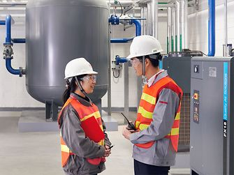 Two employees talking in production.