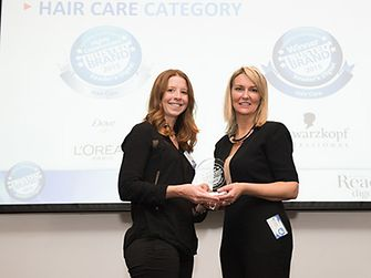 Jodie Lynch (left), Marketing Manager, Henkel Beauty Care, receiving the Most Trusted Brand Award from Sheron White (right), Group Advertising Director – APAC, Reader's Digest.