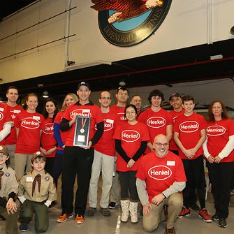 Following an awards presentation held during the opening ceremony of the Special Olympics Connecticut Winter Olympics, Henkel employees proudly display the award presented by SOCT recognizing Henkel's support of the organization.