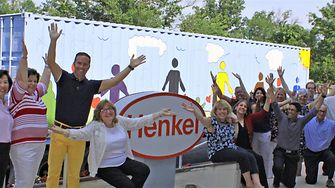 Employees excitedly bid the container-turned-classroom a hearty farewell.