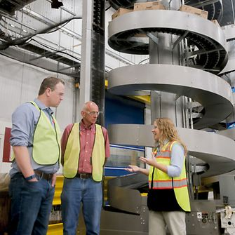 Henkel Mechanical Engineer Katie Yates (right) guides school leaders during an SCK Launch externship in Bowling Green.