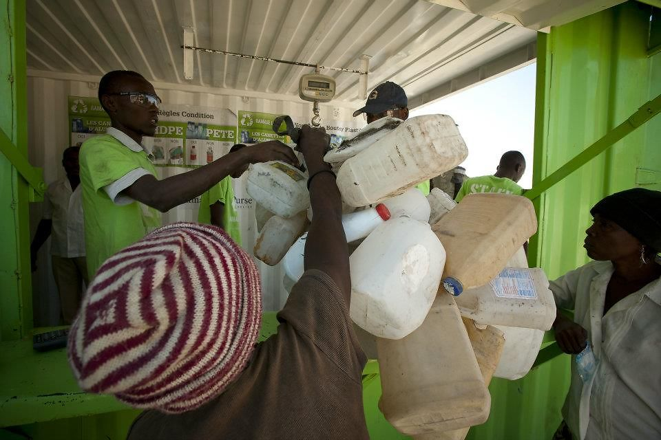 The Plastic Bank creates a ladder of opportunity: People living in poverty can collect plastic waste from the local environment and bring it to a plastic collection center.