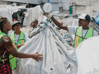 The materials are sorted and weighed, before collectors choose either a cash payment, items such as cooking fuel, or services like mobile phone charging or internet access.