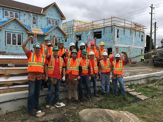 Henkel volunteers from our Mississauga, Canada office give a cheer at the start of their day building townhouses with Habitat for Humanity®.