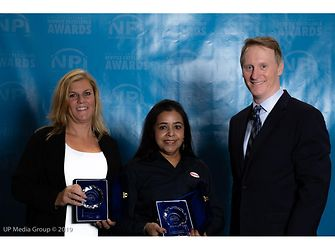 (From L to R) Henkel's Chris Maksud, Regional Sales Director Automotive Electronics, and Rita Mohanty, Director of Technical Customer Service,Thermal, accept NPI Awards from Circuits Assembly magazine Editor-in-Chief, Mike Buetow.