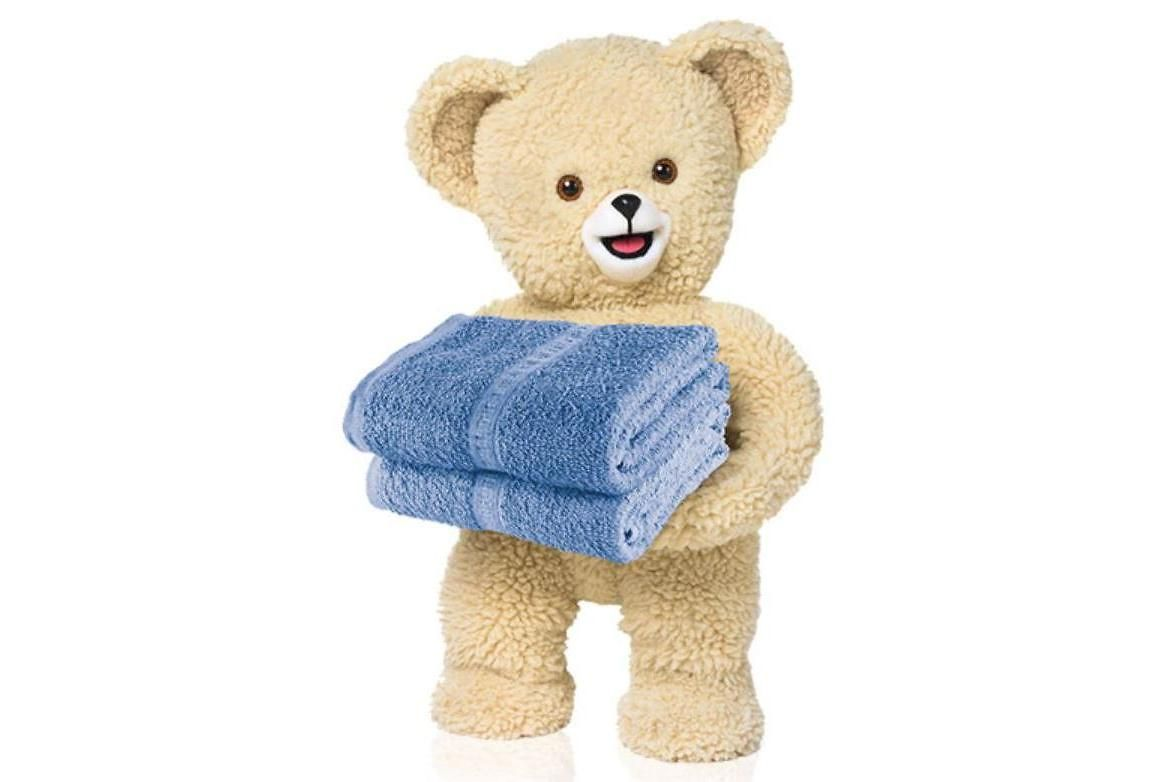 The Snuggle® Bear, a teddy bear holding two folded towels